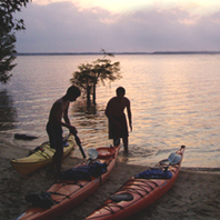 kids at lake with canoes